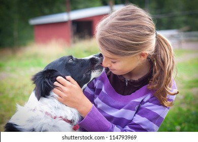 Teenage child with border collie. Soft focus, vignette