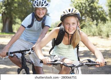 Teenage Couple Cycling Through Countryside