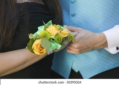 Teenage couple holding hands, close-up of hands
