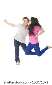Teenage couple jumping with joy