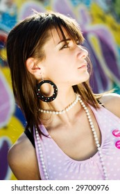 Teenage with different accessories, with a graffiti background, fashion look