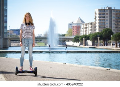 teenage face , standing on his hoverboard in a modern urban landscape waterfront