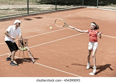 Teenage female player on tennis class outdoors