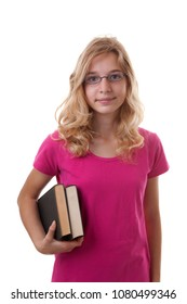 Teenage female student is looking in camera holding books over white background
