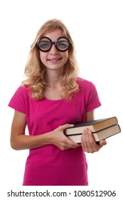 Teenage female student is looking in camera with weird glasses on holding books over white background