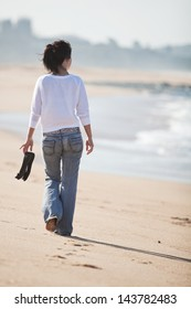 Teenage female walking on the beach