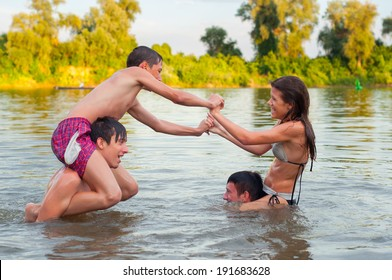 Teenage friends having fun in the river on beautiful summer day.