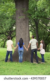 Teenage friends spending time together at tree