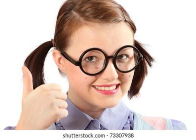 Teenage geeky girl raising thumbs-up to the camera