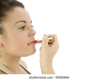 teenage girl applying lipstick on a white background