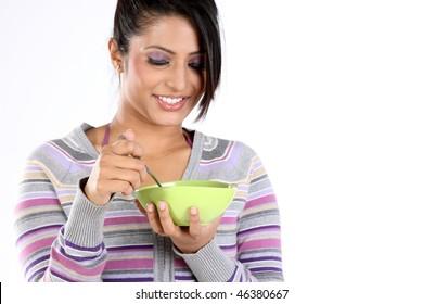 Teenage girl with bowl of breakfast