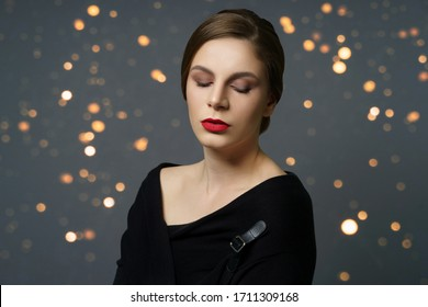 Teenage Girl with bright makeup next to grey background with flares