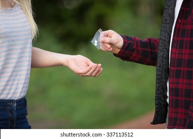Teenage Girl Buying Drugs In Playground From Dealer