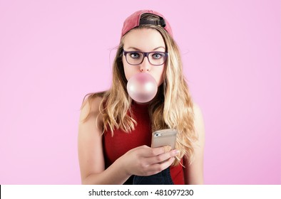 Teenage girl with candy and phone