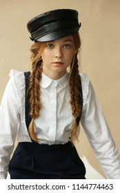 A teenage girl in a cap, fashion and style.