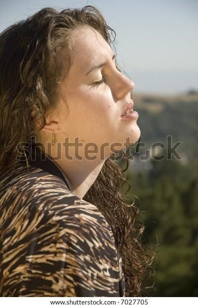Teenage girl catching some rays of sunshine