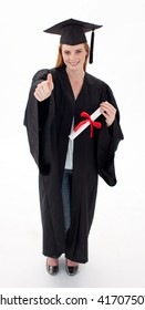 Teenage Girl Celebrating Graduation agaisnt white background with thumbs up