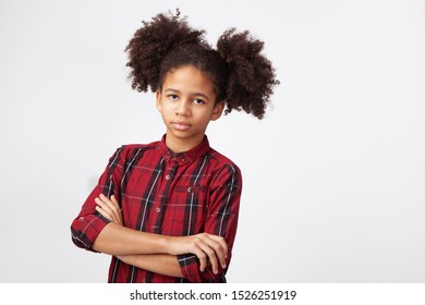 Teenage girl in chequered shirt against white background