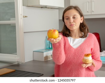 teenage girl chosen with a  sweet pastry and organic apple
