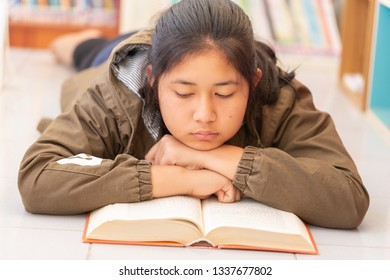 Teenage Girl Customers Reading in the Library
