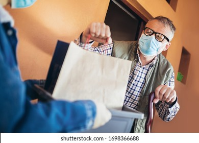 Teenage girl is delivering some groceries to an elderly person. Contactless delivery during the quarantine