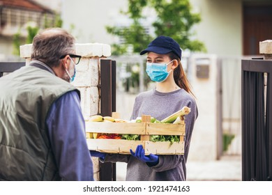 Teenage girl is delivering some groceries to an elderly person, during the epidemic coronovirus, COVID-19.