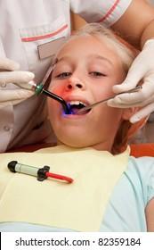 Teenage girl at a dentist.