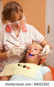 Teenage girl at the dentist.