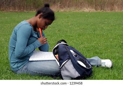 A teenage girl doing homework.