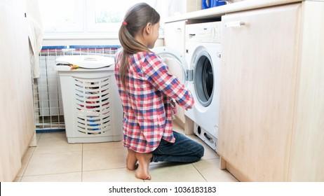 Teenage girl doing housework in laundry room
