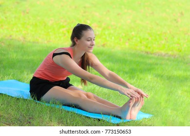 Teenage girl doing yoga pose meditation and Ballet in the public park, Healthy body posture with happy feeling in the morning. Sport concept.