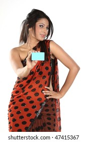 Teenage girl in dots sari with blue credit card