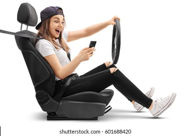 Teenage girl driving and looking at her phone isolated on white background