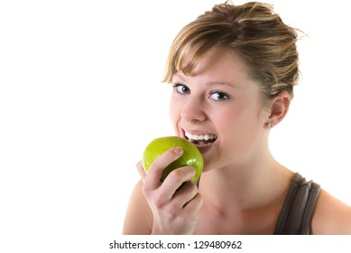 Teenage girl eating an apple. Isolated on white background