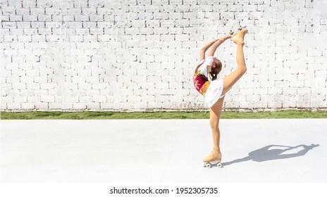 Teenage girl in elegant costume practicing figure skating on four wheels. Exercise the basket or diamond