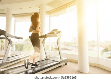 Teenage girl exercise on running machine