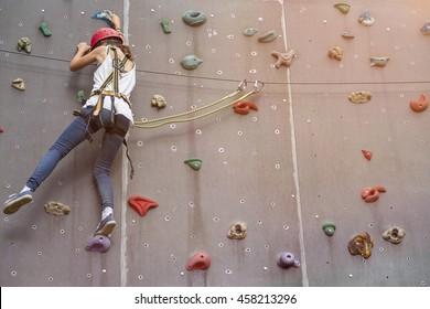 teenage girl in a free climbing wall