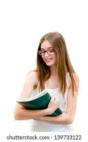 Teenage girl in glasses holding book and smiling on white copyspace background