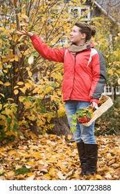 Teenage girl in golden fall foliage