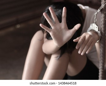 Teenage girl hands in handcuffs. young girl violence and abuse concept. human trafficking. Stop violence against women.