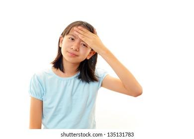 A teenage girl with headache