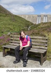 teenage girl hiking in the mournes wearing rucksack