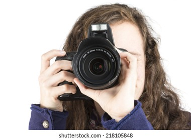 A teenage girl holding a camera to take a picture