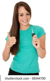 Teenage girl holding car key