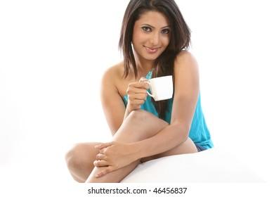 teenage girl holding cup of coffee