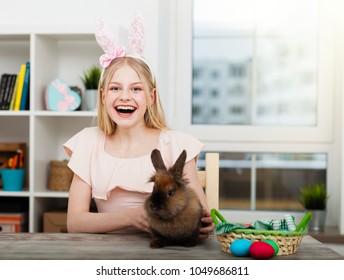 Teenage girl holding Easter eggs