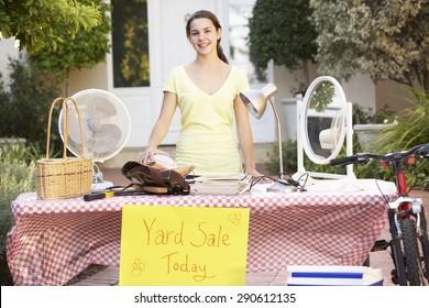 Teenage Girl Holding Yard Sale