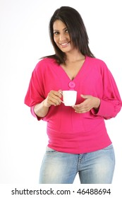 teenage girl with jeans pants and pink top holding the cup