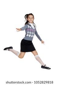 Teenage girl jumping in a white studio