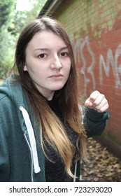 Teenage girl looking angry and ready to punch